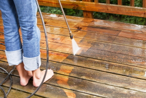 A wood deck with a pressure washer.
