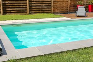 large backyard in-ground swimming pool