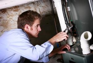 Man repairing a furnace