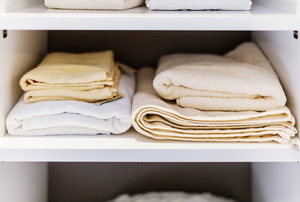A neatly stacked linen closet.
