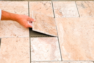 Worker Placing tiles