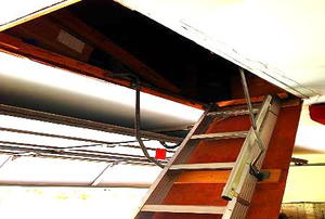A fully-extended ladder to an above-garage attic.