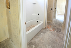 A bathtub surround in a bathroom under construction.