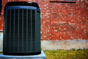 High efficiency modern heat pump unit, energy save solution in front of brick wall.