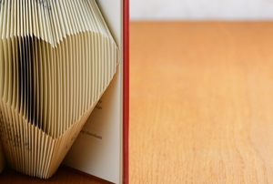 a book with pages folded into a heart shape