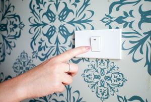 A light switch on wallpaper.