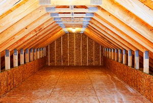 Looking down the length of a long, empty, unfinished attic.