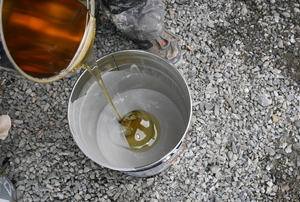 Mixing resin in a bucket