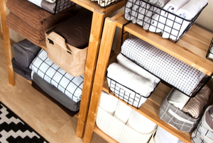 closet organizer with neat piles of clothes