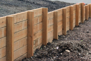 retaining wall between two plots of dirt