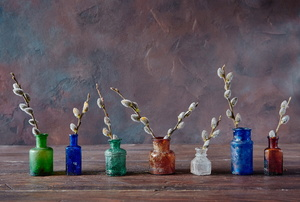 Painted jars used as vases.