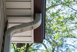 aluminum downspout attached to gutter