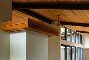 Dark beams on a lighter wooden ceiling.