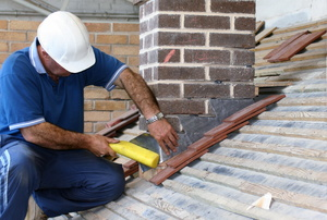 man working on chimney flashing