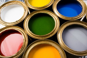 Cans of colorful paint.