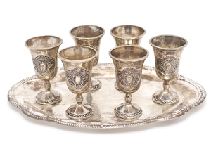 silver plated goblets on tray