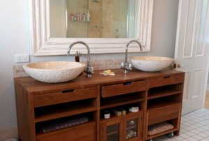 bathroom vanity with double sinks and storage.