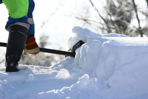 A person shoveling snow.