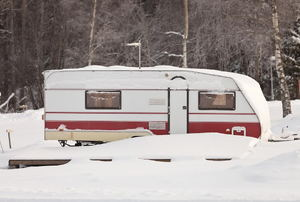 Travel trailer parked in the snow