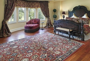 a well appointed bedroom with a Persian rug
