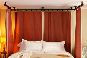 A Ceiling Mounted, Plumbing Pipe Canopy Bed.