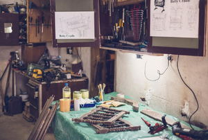 A garage with a workbench and tools.
