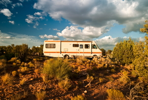 an RV surrounded by desert landscape