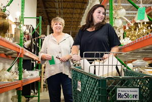 A pair of women shopping at the ReStore.