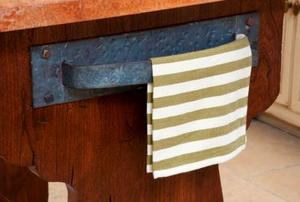 A kitchen towel hanging on a vintage handle