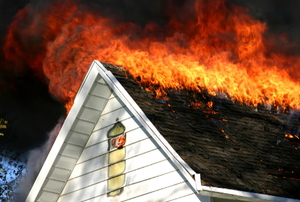 The roof of a house on fire.