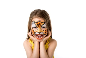 A girl with tiger face paint on a white background.