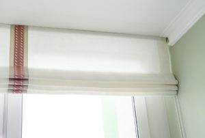 white Roman blind with vertical stripe