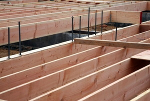 Wooden planks lined up in a foundation