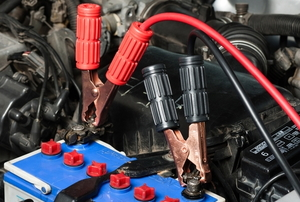 jumper cables attached to a car battery