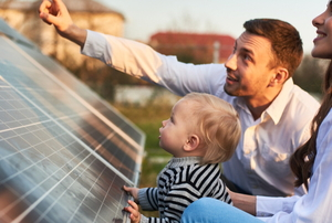 parents and young child with solar panels