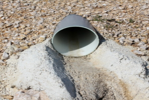 A French drain surrounded by gravel.