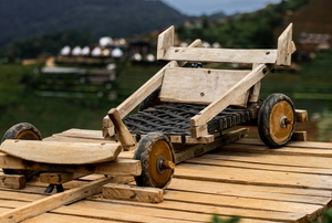 wooden go kart outside in a tropical area