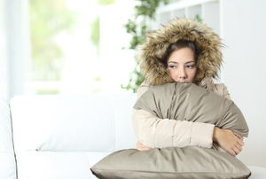 Women wrapped in warm jacket and blanket