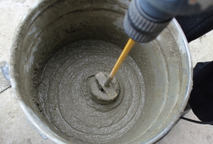 wet concrete being stirred with a mixer
