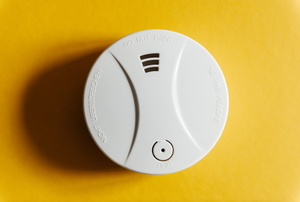 carbon monoxide detector on yellow wall