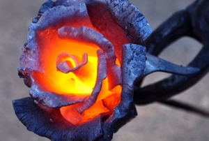 heated metal rose glowing in the center