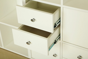 A set of offwhite cabinets with two drawers slightly open