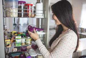 Woman looking at a food item from a pull out pantry