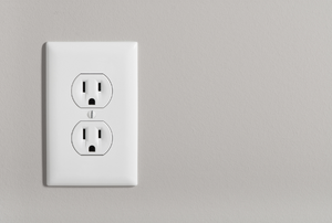 electrical outlet against a beige wall