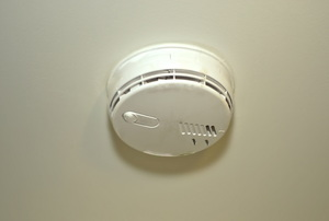 A smoke and carbon monoxide detector on the ceiling.
