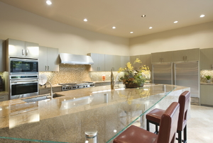 A kitchen with recess lighting.
