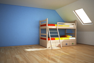 kids bunk beds in an otherwise empty room with a blue wall and wood floor
