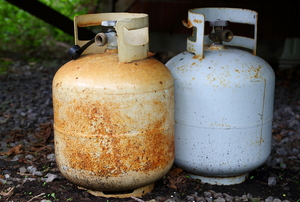 Two propane tanks.