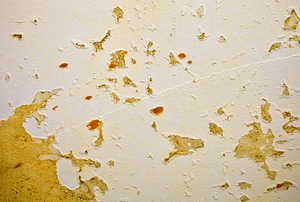 A painted wall with sticky residue on it.