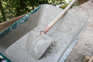 cement waiting to be mixed by a shovel in wheelbarrow
